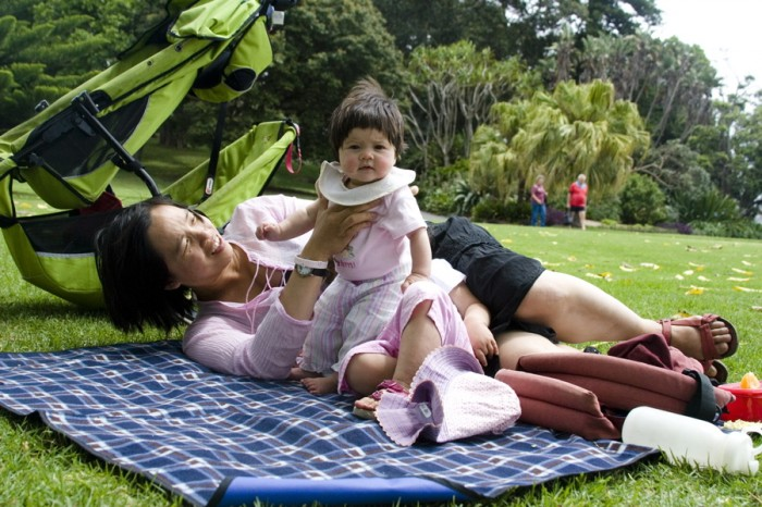 A mother is playing with a child at the Royal Botanic Gardens in Sydney, Australia.