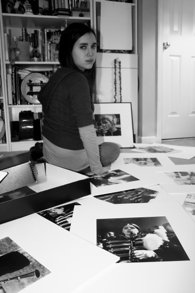 Me during my sophomore year in college with my photographs.