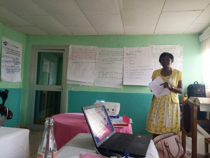 Dorcas is presenting at an HIV training.