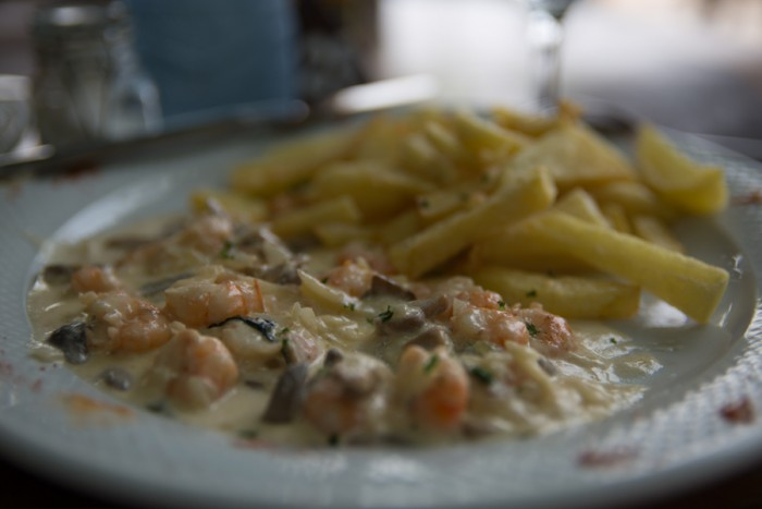 Shrimp with cream sauce and mushrooms and french fries